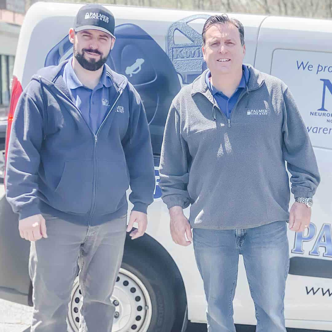 Billy and Bill Palmer in front of their locksmith van