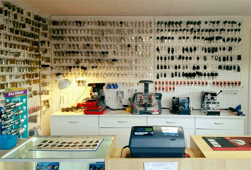 image of our huge selection of keys and a few of our key cutters in our storefront