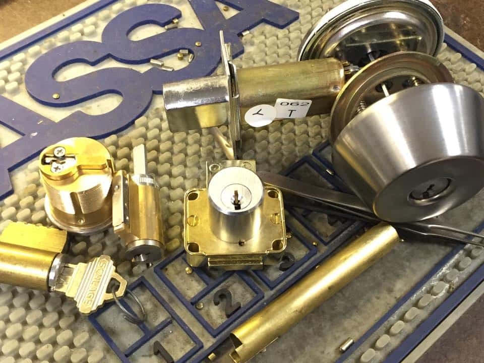 image of some locks being rekeyed to all work with a new key.